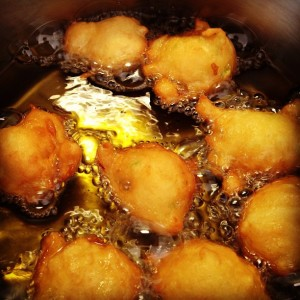 anna's donut fritters cooking in oil